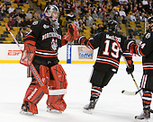 Chris Rawlings (Northeastern - 37), Wade MacLeod (Northeastern - 19), Tyler McNeely (Northeastern - 94) - The Boston College Eagles defeated the Northeastern University Huskies 5-4 in their Hockey East Semi-Final on Friday, March 18, 2011, at TD Garden in Boston, Massachusetts.