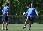 Head coach Bruce Arena (r) passes the ball to team press officer Michael Kammarman (l) on Tuesday, May 16th, 2006 at SAS Soccer Park in Cary, North Carolina. The United States Men's National Soccer Team held a training session as part of their preparations for the upcoming 2006 FIFA World Cup Finals being held in Germany.