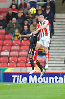 28.02.2015.  Stoke, England. Barclays Premier League. Stoke City versus Hull City. Stoke City forward Jonathan Walters wins the header from Hull City defender Maynor Figueroa
