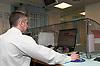 Desk sergeant on duty in Bishopsgate Police Station, City of London