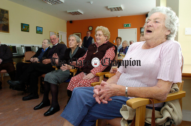 Maura Sheils, right, sings a song for all her friends at the Bealtaine Festival concert in the day care centre at Kilmaley. Photograph by John Kelly.