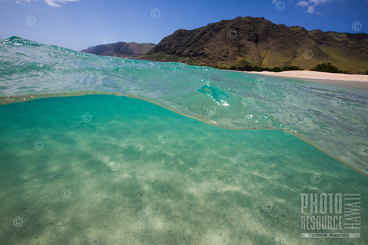View of Makua Bay and beach from above and below the water