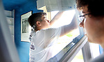 WATERBURY CT. 17 May 2019-051719SV01-From left, Chris Aceves, 17, of Meriden and Derek Strillacci, 18 of Southington install a window with Tonnotti Windows at a home in Waterbury Friday. The students from Wilcox Tech. are part of an apprenticeship program.<br /> Steven Valenti Republican-American