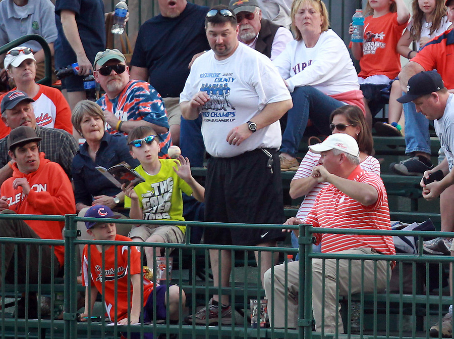 Virginia fans ware surprised ball a foul ball during the game against Clemson Friday at Davenport Field in Charlottesville, VA. Photo/The Daily Progress/Andrew Shurtleff