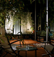 A warm and sensual atmosphere is created by hidden uplighters in a Japanese-inspired garden