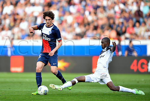 31.08.2013. Paris, France. French League football. Paris St Germain versus Guingamp Aug 31st.  Adrien Rabiot (psg) - Mustapha Diallo (gui)
