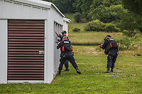 CERT Corrections emergency response  team from Elmira doing a  door to door search outside of Friendship, NY for escaped felons David Sweat and Richard Matt. Photo by Brendan Bannon. June 21, 2015.