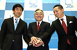 September 26, 2017, Tokyo, Japan - Japan Display Inc. (JDI) chairman Nobuhiro Higashiiriki (C) shakes hands with newly appointed executives Kazutaka Nagaoka (L) and Yoshiaki Ito as they announce the company's structural reform plan and new products of Full Active display panel in Tokyo on Thursday, September 26, 2017. Full Active display has ultra slim bezel of about 5mm.   (Photo by Yoshio Tsunoda/AFLO) LWX -ytd-