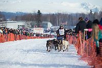 Ramey Smyth runs down the chute on Willow Lake after leaving the re-start line of the Iditarod sled dog race in Willow, Alaska Sunday, March 3, 2013.