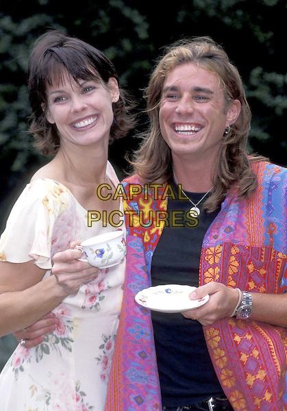 ALEXANDRA PAUL & JAASON SIMMONS.24 July 1996.ref:3096.half length, half-length, teacup.www.capitalpictures.com.sales@capitalpictures.com.©Capital Pictures