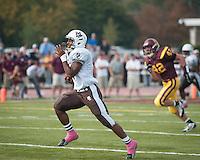 Mt. Carmel's Matt Domer breaks through the loyola defense for a ninety-six yard touchdown run