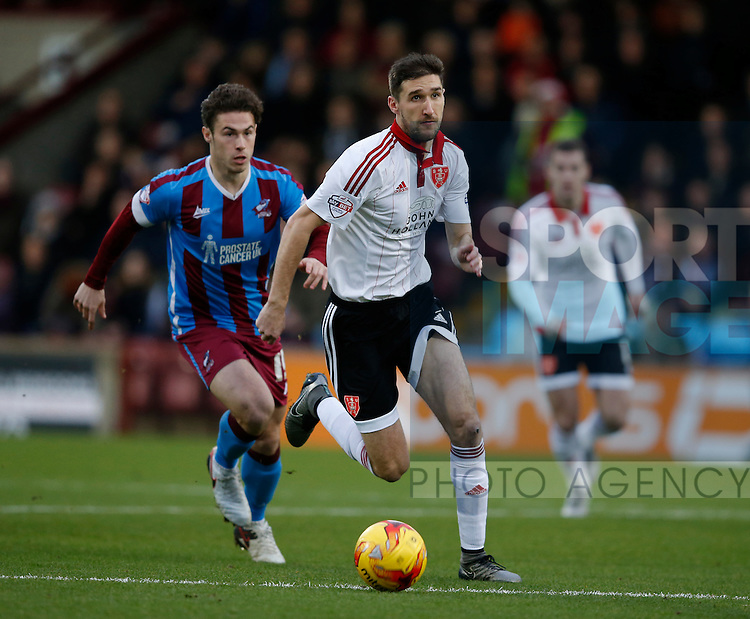 Chris Basham of Sheffield Utd gets ahead of Tommy Rowe of Scunthorpe Utd - English League One - Scunthorpe Utd vs Sheffield Utd - Glandford Park Stadium - Scunthorpe - England - 19th December 2015 - Pic Simon Bellis/Sportimage