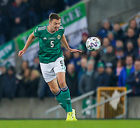 16th November 2019; Windsor Park, Belfast, Antrim County, Northern Ireland; European Championships 2020 Qualifier, Northern Ireland versus Netherlands; Jonny Evans of Northern Ireland heads the ball mid-pitch - Editorial Use