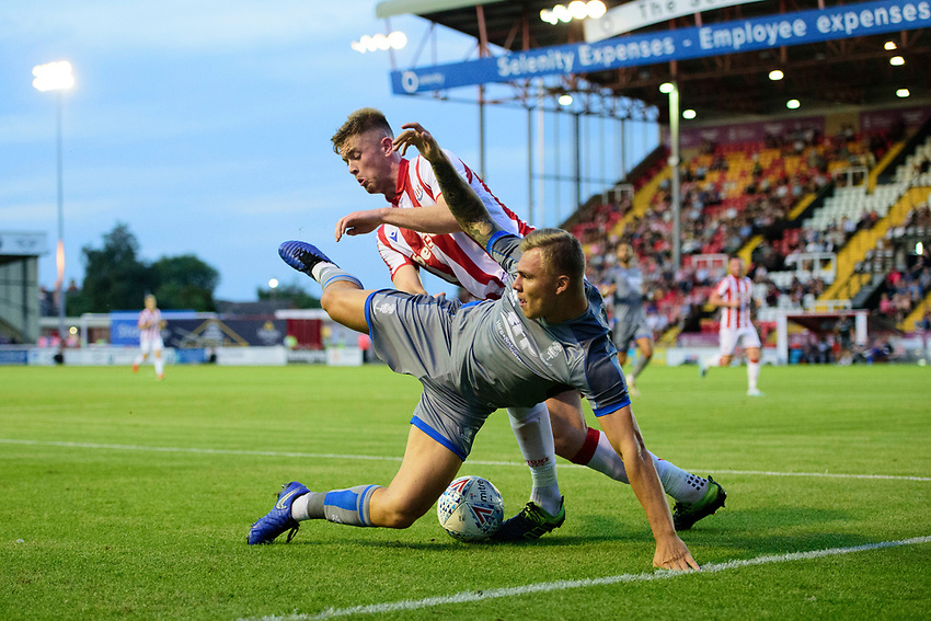 Lincoln City's Harry Anderson vies for possession with Stoke City's Nathan Collins<br /> <br /> Photographer Chris Vaughan/CameraSport<br /> <br /> Football Pre-Season Friendly - Lincoln City v Stoke City - Wednesday July 24th 2019 - Sincil Bank - Lincoln<br /> <br /> World Copyright © 2019 CameraSport. All rights reserved. 43 Linden Ave. Countesthorpe. Leicester. England. LE8 5PG - Tel: +44 (0) 116 277 4147 - admin@camerasport.com - www.camerasport.com