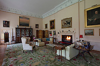 The drawing room, originally the ballroom, is graced with a classical cornice. The painting above the fireplace, Shuttleback adn Diver, is attributed to Benjamin Marshall. The Portuguese carpet was paid for by American clansman Malcom Munroe, son of the manufacturer of the first calculating machines