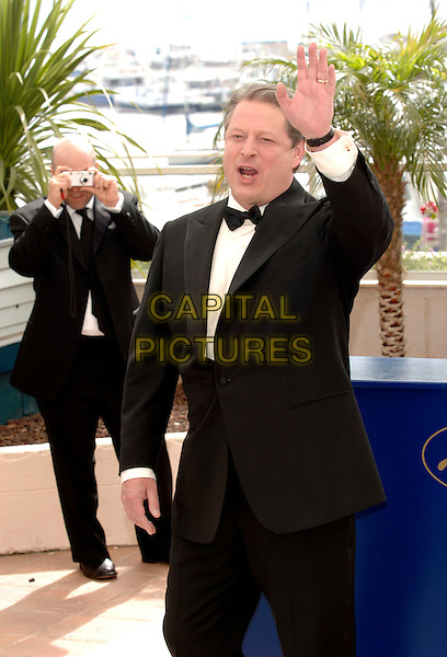 "AL GORE .Former vice president of the United States attends photocall for  ""An Inconvenient Truth"" premiere.59th International Cannes Film Festival, France.20th May 2006.Ref: PL.half length bow tie  waving hand.www.capitalpictures.com.sales@capitalpictures.com.©Phil Loftus/Capital Pictures"