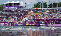 09 AUG 2012 - LONDON, GBR - Competitors swim past the main grandstand at the start of the London 2012 Olympic Games women's 10km Marathon Swimming in Hyde Park, London, Great Britain (PHOTO (C) 2012 NIGEL FARROW)
