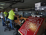 Farmingdale, New York, USA. January 21, 2018. At left, JOHN MASSEY works one of three controller boards up in loft of TMB Model Train Club during Open House at its Headquarters.