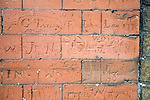 Eighteenth century graffiti scratched on brick wall of school building, Dedham, Essex