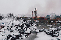 Fires burn at the DAPL resistance camps near Cannon Ball, ND as people attempt to clean up as much as possible before the afternoon eviction on Wednesday, February 22, 2016.