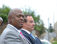 August 25, 2011 (Washington, DC)  Harry E. Johnson Sr., (left) president & CEO of the Martin Luther King, Jr. National Memorial Project Foundation, Inc. listens at a press conference on August 25, 2011, held by DC Mayor Vincent Gray (D-DC) announcing the designation of the Southeast/Southwest Freeway, the 11th Street Bridge and sections of Maine and Independence Avenues SW as Martin Luther King, Jr. Drive.   (Photo by Don Baxter/Media Images International)