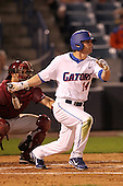 "Florida Gators Kamm Washington #14 during a game vs. the Florida State Seminoles in the ""Florida Four"" at George M. Steinbrenner Field in Tampa, Florida;  March 1, 2011.  Florida State defeated Florida 5-3.  Photo By Mike Janes/Four Seam Images"