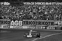 Jody Scheckter drives the six-wheel Tyrrell P34 Formula 1 car to victory during the 1976 Grand Prix of Sweden at Anderstorp.