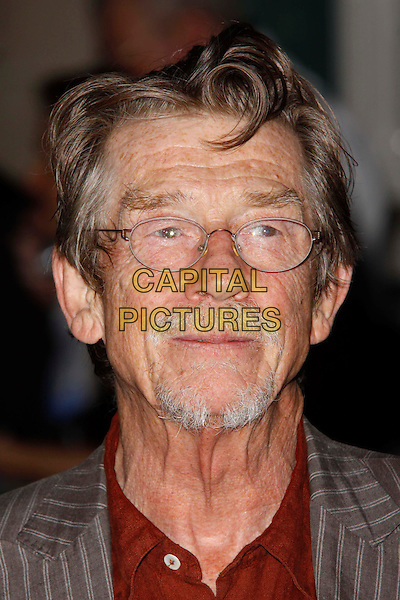 John Hurt.UK Premiere of 'Melancholia' at the Curzon, Mayfair, London, England..September 28th 2011.headshot portrait grey gray pinstripe suit jacket red shirt glasses goatee facial hair.CAP/AH.©Adam Houghton/Capital Pictures.