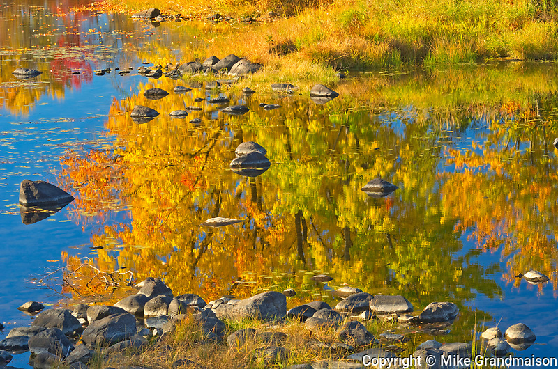 Autumn colors and rocks along the Vermilion River in the Sudbury District. The river flows into Lake Huron<br />