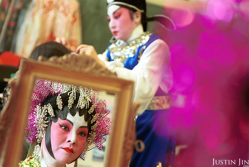 Netherlands, Amsterdam, 02-2002..Dutch-Chinese preparing for an opera performance.  Elderly. Old age. Pension. Chinese. Culture. Allochdtonen. Opera. Arts..Foto: Justin Jin