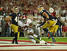 Jan. 7, 2013;  Alabama wide receiver Amari Cooper scores a touchdown past Notre Dame safety Matthias Farley and Zeke Motta during the second half of the 2013 BCS National Championship  in Miami, Florida. Alabama defeated Notre Dame 42 to 14. Photo by Barbara Johnston/University of Notre Dame