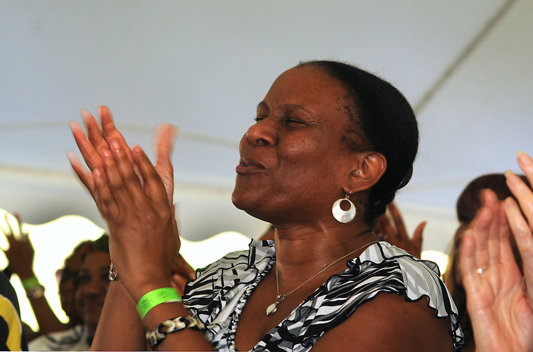 Member of the audience seen during the performance of, The Message (an All-Star Band inspired by the legacy of Art Blakey's Jazz Messengers) at the 2014 Jazz in the Valley Festival held in Waryas Park on the Hudson River front in Poughkeepsie, NY on Sunday August 17, 2014. Photo by Jim Peppler. Copyright Jim Peppler 2014 all rights reserved.