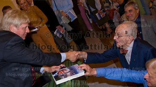 Mayor Istvan Tarlos is greeted by lawyer Gyorgy Barandi after an official event presenting his new book about the capital city.