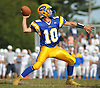 East Meadow quarterback No. 10 Anthony LaRosa throws a pass for a 43-yard completion during a Nassau County Conference I varsity football game against Oceanside at East Meadow High School on Saturday, September 26, 2015. Oceanside won by a score of 14-7.<br /> <br /> James Escher