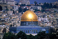 View of the golden Dome of the Rock, sacred Islamic shrine located in Jerusalem. It was completed in Jerusalem by the Caliph Adg-al-Malik. Other buildings and structures of Jerusalem are visible in the background. Jerusalem, Israel.