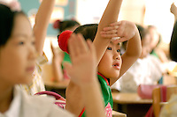 Children in a classroom at the first primary school attached to the XuanWu District normal school. XuanWu is located the south western part of the central city area, just outside the Imperial Inner City. In 2010, Xuanwu District was merged into Xicheng..