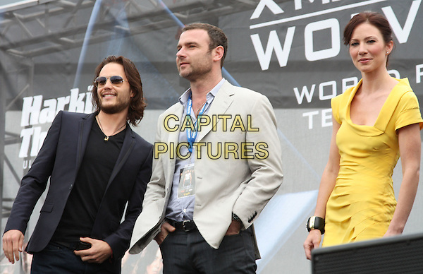 TAYLOR KITSCH, LIEV SCHREIBER, LYNN COLLINS .Hollywood Yates. 'X-Men Origins: Wolverine' World Premiere held at Harkins Theatres, Tempe, AZ, USA, .April 27th 2009..half length yellow dress cream jacket sunglasses black grey gray navy blue .CAP/ADM/DC.©Darrylee Cohen/AdMedia/Capital Pictures