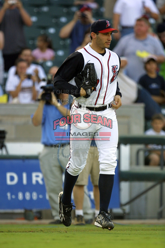 Houston Astros pitcher Andy Pettitte (37) jogs to the mound before his first rehab start with the Round Rock Express of the Texas League on June 18, 2004 at the Dell Diamond in Round Rock, Texas. (Andrew Woolley/Four Seam Images)