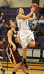 SIOUX FALLS, SD - JANUARY 30:  Marie Malloy #4 from the University of Sioux Falls lays the ball up past Taylor Meyer #42 from Minnesota Duluth Friday night at the Stewart Center. (Photo by Dave Eggen/Inertia)