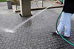 Cleaning with water, reinigen mit Wasser, Wasserschlauch, Schlauch, Hand, Vaduz, Liechtenstein