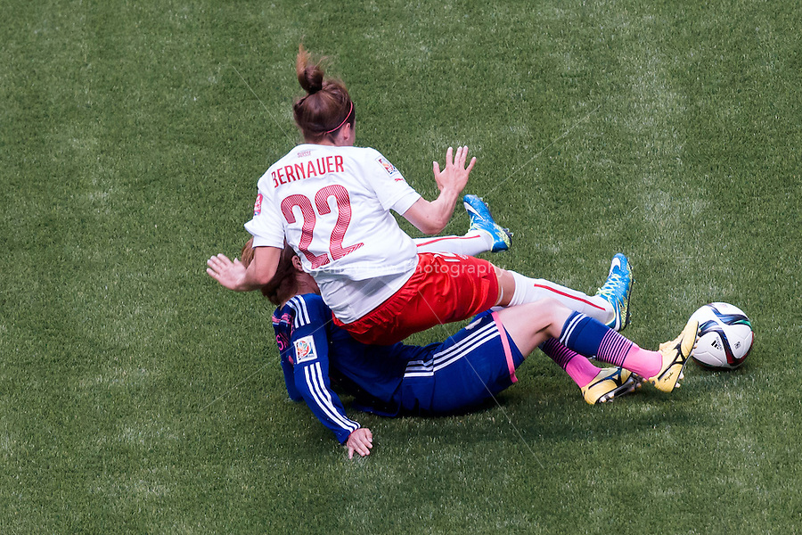 June 8, 2015: Vanessa BERNAUER of Switzerland is fouled during a Group C match at the FIFA Women's World Cup Canada 2015 between Japan and Switzerland at BC Place Stadium on 8 June 2015 in Vancouver, Canada. Sydney Low/AsteriskImages