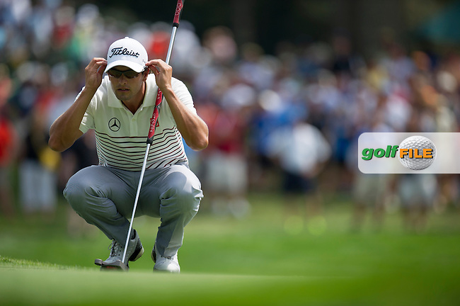Adam Scott checks his line during the opening round of the PGA Championship at Oak Hill Country Club (Photo: Anthony Powter) www.golffile.ie