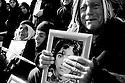 Iraq 2008.In Dukan, during the ceremony when coffins of Anfal victims are bringing back to Kurdistan, relatives with photos of the victims   Irak 2008. A Dokan,pendant la ceremonie du retpur des cercueils des victimes de l'Anfal, des familles avec les photos de leurs disparus