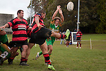 Carl Selby reaches high to try & charge down Chris Mana's defensive clearing kick. Counties Manukau Premier Club Rugby Game of the Week between Drury & Papakura, played at Drury Domain on Saturday Aprill 11th, 2009..Drury won 35 - 3 after leading 15 - 5 at halftime.