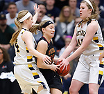 SIOUX FALLS, SD: MARCH 10:  Brynn Flakus #23 of Northern State tries to get through Augustana defenders  during the 2018 NCAA Division II Women's Basketball Central Region Tournament at the Elmen Center in Sioux Falls, S.D.    (Photo by Dick Carlson/Inertia)