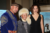 """LOS ANGELES, CA - OCTOBER 18: Nurgaiv Rys, Aisholpan Nurgaiv, Daisy Ridley at the """"The Eagle Huntress"""" Premiere at the Pacific Theaters at the Grove, Los Angeles, California on October 18, 2016.  Credit: David Edwards/MediaPunch"""