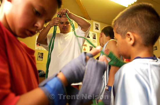 Boxer Gary Gomez and kids training at the gym in his garage.<br />