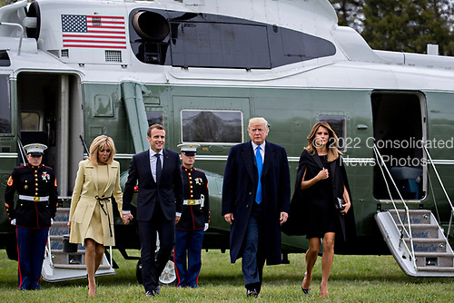 U.S. First Lady Melania Trump, from right, U.S. President Donald Trump, Emmanuel Macron, France's president, and Brigitte Macron, France's first lady, arrive from Marine One at the Mount Vernon estate of first U.S. President George Washington in Mount Vernon, Virginia, U.S., on Monday, April 23, 2018. As Macron arrives for the first state visit of Trump's presidency, the U.S. leader is threatening to upend the global trading system with tariffs on China, maybe Europe too. <br /> Credit: Andrew Harrer / Pool via CNP
