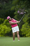 SINGAPORE - MARCH 05:  Christina Kim of the USA plays a shot on the par five 5th hole during the first round of HSBC Women's Champions at the Tanah Merah Country Club on March 5, 2009 in Singapore.  Photo by Victor Fraile / The Power of Sport Images