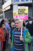 Ian Saville, socialist magician.  Black Lives Matter, Stand Up To Racism protest in Harlesden, London, outside a cafe where a young black man was assaulted by police.